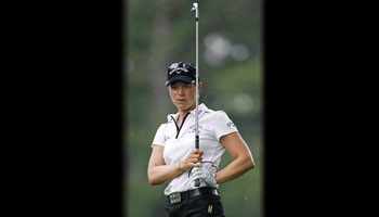 Annika Sorenstam after a golf swing.
